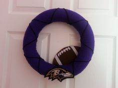 Baltimore ravens NFL yarn wreath on Etsy, $35.00 (I'd make this for the Colts instead for my friends and family who are football fans)