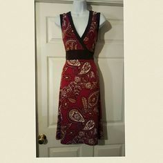 Burgundy paisely print vneck jersey knit dress Apt 9 sleeveless Burgundy  colored paisely print vneck jersey knit dress with black trim around  the v neckline, waistline and hem apt 9 Dresses