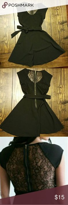 """Black cocktail dress small black cocktail dress. Zip up back with lace. This dress is short and hits high thigh. I'm 5'6"""" and normally wear a size 2. Fits great! manteau Dresses"""