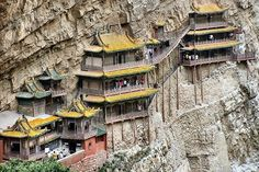 Hanging Monastery, China  The Hanging Monastery or Hanging Temple is located in a canyon at the foot of the Mountain Heng in the province of Shanxi, China. The temple is built into the cliff side about 75 meter above the ground, and stands propped up by hidden rocks corridor and wooden beams inserted into the mountain. Over 40 halls, cabinets and pavilions within an area of 152.5 square meters are connected each other by corridors, bridges and boardwalks