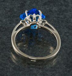 Fleur de lis design Custom Cut Blue Quartz Gem Ring. $250.00, via Etsy.