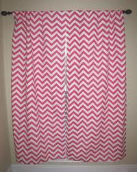 pink chevron curtains for baby girls room. Navy blue walls.