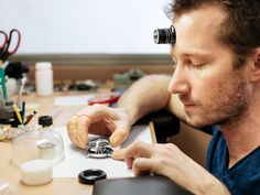 A craftsman carefully placing the domed sapphire crystal cupola over the dial of the Legacy Machine aka at MB&F atelier. Swiss Watch Brands, Wood Watch, Craftsman, Sapphire, Rings For Men, Industrial, Watches, Crystals, Luxury