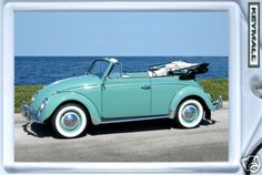 This was just like my very first car.  I bright turqoise VW convertible with a black top.  I named her Fat Ruth.  She was the best car ever!