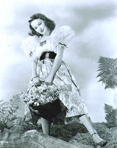 Olivia De Havilland basket of flowers on set 1940s