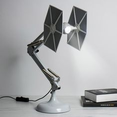 The Firebox Tie Fighter desk lamp is perfect for any fan . - The Firebox Tie Fighter desk lamp is perfect for any Star Wars fan - Decoration Star Wars, Star Wars Decor, Star Wars Art, Star Wars Light, Tie Fighter, Bedroom Lamps, Bedroom Lighting, Lego Bedroom, Childs Bedroom