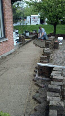 New sand screeded and pavers being relaid. | www.paverprotector.com #paverprotector