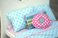 Tutorial on sewing doll bedding. Plus a simple and easy to make DIY Doll Bed that fits American Girl Dolls