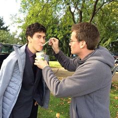 fishingboatproceeds:  Feeding soup to a freezing Nat Wolff (aka Isaac) on the set of The Fault in Our Stars. Could it be any more perfect?!