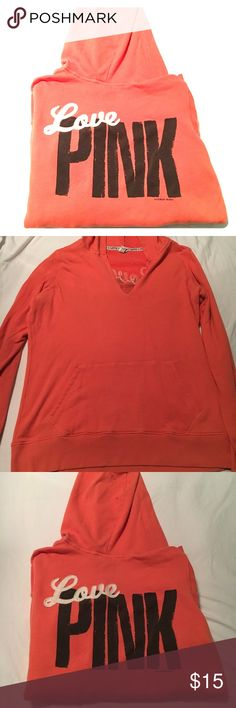 Oversized Victoria's Secret Pink Hoodie Oversized orange VS Pink boyfriend sized hoodie. I don't know why it photographed coral, but it's a true orange in person. Medium, but VERY oversized, super comfy for lounging and going to class on chilly mornings. Has one small stain on the front, I tried to capture it, but it didn't photograph well. Not very noticeable though. No rips, tears, or weird smells. From a smoke free home. PINK Victoria's Secret Tops Sweatshirts & Hoodies