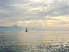Photo about A sailboat on lake leman shimmering water. Image of water, sailing, lake - 71406455 Travel Europe, Sailboat, Sailing, Spain, France, Stock Photos, Celestial, Water, Outdoor