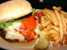 Northern Italian Burger Melt at Features Sports Bar and Grill West Salem: A ½ pound burger topped with a spicy Italian sausage patty, mozzarella cheese, bruschetta tomatoes and fried Italian pepperoncini bites on a grilled focaccia roll.
