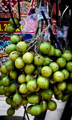 These are Quenepas from Puerto Rico, otherwise known as JA: Guineps / Nica: Mamoncillo / Haiti: Quenepe ...among other wordsN en El Salvador mamones y solo en Sta Ana, Talpajocotes