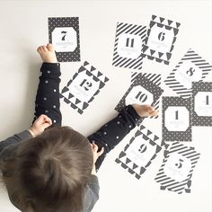 Commemorate each month of your baby's first year with the Emily and Meritt for Pottery Barn Kids black and white milestone card downloads.