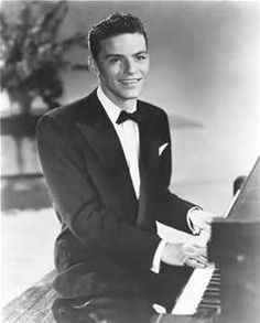 Frank Sinatra. Great actor,singer dancer. (looks like he plays the piano too!