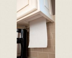 Space Saving Under Cabinet Paper Towel Holder from Master Design Cabinetry: Gallery | Accessories