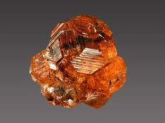 Grossular  Locality:	 Jeffrey Mine, Asbestos, Les Sources RCM, Estrie, Québec, Canada	  Dimensions:	 1.6 x 1.8 cm  Description:	 Grossular var. hessonite