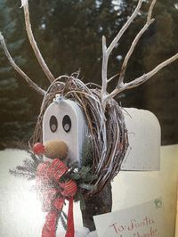 Mailbox reindeer: Grapevine wreath, twigs, water bottle and foam ball for the nose, magnets for eyes.