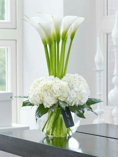 luxury cars - Luxury Calla Lily & Hydrangea Vase This contemporary designer arrangement is right on trend We've chosen ultrafashionable calla lilies in pristine white and created a surround of sumptuous hydrangea blooms with their richly textured flowers Flower Centerpieces, Flower Vases, Flower Decorations, Wedding Centerpieces, Bouquet Flowers, Vase For Flowers, Lilies Flowers, Lily Bouquet, Tall Centerpiece