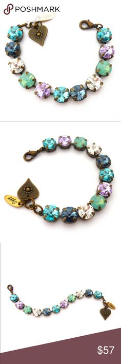 Chunky Swarovski Rivoli Crystal Bracelet Chunky crystal bracelet featuring genuine Swarovski 11mm (47ss) rivolis in a shimmering mix of light turquoise, denim blue, clear, violet and Pacific opals. The finish is antique brass which is nickel-free. Gift packaging is included. Siggy Jewelry which launched in 2012 has become a well known brand sold word wide. You will not be disappointed. The many glowing reviews submitted by happy customers speak for themselves. Thanks for shopping and sharing…
