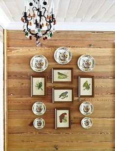 boards for the wall, painted board ceiling, arrangement of plates and prints, chandelier