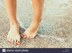 Girl With Hydrophobia (Fears Of Water) On The Beach Stock Photo