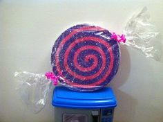 Candyland Decorations - cardboard cut in circles painted and glittered wrap in cellophane
