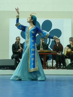 Related modern Persian costume that also includes a sheer, floor-length skirt over the pantaloons but under the coat