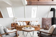 Before and After: An A-Frame Cabin Boasts Serious Scandinavian Vibes - Photo 6 of 14 - Slate gray Xander armchairs from World Market