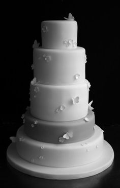 Sugarplum Cake Shop ❥ Lovely Delicate White Fondant Multi-Layer Wedding Cake with White/Light Gray and Tiny Butterflies
