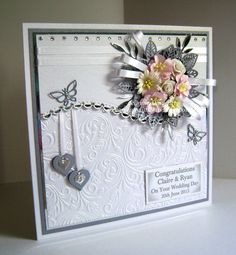 Wedding Card in White, Silver Foil and Silver Pearl - using dies from Spellbinders - Grand Squares, Borderabilities Curved Borders 1and Rectangle, Sue Wilson's - Faux Leaves, Memory Box - Leaf, Joy Crafts - Butterflies and Nellie Snellen - Hearts, Embossing Folder from Crafters Companion - Rose Swirls. Flowers from Wild Orchid Crafts.