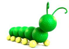 """Experienced"" golf balls are transformed into delightful critters to display in your home, office or garden. Each one is precision drilled, wired and painted. There is no glue used on our golf balls! Cody is a very hungry caterpillar and knows that one day he will become a butterfly. But for now, he is more than happy to feast on the plentiful greenery around the golf course. Available for purchase on etsy."