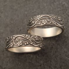 """These wedding bands were inspired by an architectural detail from an art deco building in New York City. They feature a beautiful, crisp stylized ivy pattern with elegant leaves, flowers, and vines on a plain background. Both rings are just under 1/4"""" wide (5.5mm) and are 1/16"""" thick (1.5mm).  They are shown in sterling silver."""