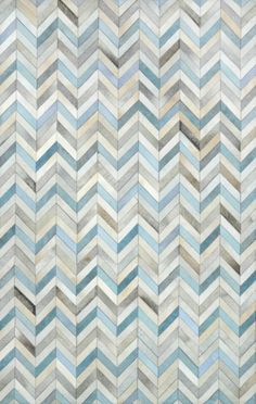 neutral + touch of blue herringbone cowhide rug // rugs usa
