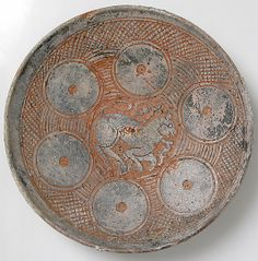 Bowl with Lioness. 1100–1300, Byzantine, 2 1/4 x 10 3/8 in.