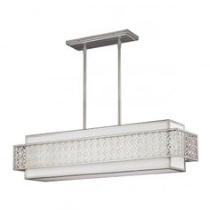 The transitional Kenney collection is an updated take on a classic, mid-century modern design in a sunset silver finish. This 5 light ceiling pendant bar features a square inner shade nestles within an intricate outer band of metal fretwork. The angular design makes this a contemporary option to instantly modernise any space. Supplied with a selection of suspension rods which can be adjusted at the point of installation to suit most ceiling heights. This is ideal over kitchen islands and…
