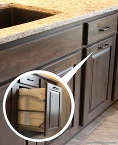 A Galesburg, IL kitchen with a pull-out trash basket included in the cabinet design.    |   VillageHomeStores.com