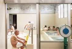 Tokyo based Schemata Architects kept traditional elements, such as the half wall separating the men and women's bathing areas, but introduced contemporary colour schemes and attractions for younger bathers. Hoshi, Tokyo Architecture, Cultural Architecture, Deprivation Tank, Lavatory Design, Mont Fuji, Open Ceiling, Japanese Bath, Tokyo Hotels