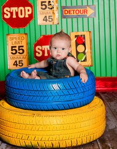 LOL - I am not sure how this little one is not falling through the centre of the tire here, but what a great #photography prop! #upcycle #tire