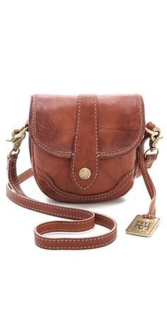 Frye Campus Mini Cross Body Bag -  FREE SHIPPING at shopbop.com. This sturdy little bag from Frye is crafted from worn, variegated leather in a scaled-down satchel silhouette. Brass hardware and topstitching completes the vintage aesthetic, and the detachable cross-body strap is adjustable.