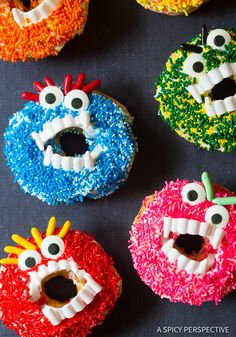 Fun Halloween Monster Donuts - Simple halloween treats using store-bought doughnuts, frosting, sprinkles, and plastic vampire fangs. Kids love to make