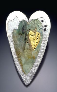 Mary Rogers | Amulet Heart #9 Brooch.......Connie Fox: Unity achieved by repetition of hearts using different materials.