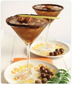ingredients  1 DOVE CHOCOLATE DISCOVERIES™ (DCD) Chef Series Dark Chocolate bar - melted and/or tempered,  DCD Cocoa Powder,  2 ounces vanilla vodka,  2 ounces DCD Chocolate Martini Mix,  2 ounces pecan-flavored liqueur,   2 cups crushed ice,  1 jar caramel ice cream topping,  1 toasted pecan - for garnish,  1 DCD Chocolate Ruffle - for garnish  PREPARATION  1. Rim your favorite martini glass in tempered chocolate or cocoa powder. (You can also try drizzling some caramel sauce and melted chocolate on the inside of the glass for an elegant design.) Set martini glass aside.  2. Shake the vodka, martini mix, and praline liqueur in a martini shaker with ice to chill. (Fill the martini glass almost full with crushed or shaved ice, being careful not to touch the rim.)  3. Strain drink into the martini glass, and garnish with a toasted pecan and/or chocolate ruffle.