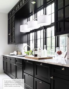 This is my ride or die kitchen... glossy black with tons of light and marble counters. ...   mmmmmmm....