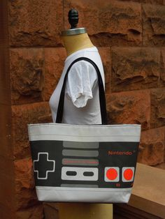 Large Printed Retro NES Nintendo Controller Handbag with Silver Studded Hardware and Snap Closure. $75.00