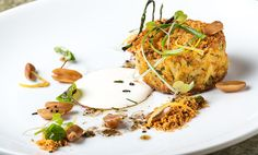 Crab Cake with Asparagus, Tomato Chimichurri and Cured Egg Yolk.