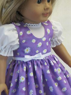 This is a sweet little outfit for your 18 American Girl doll. The fabric has bright white daisys scattered on a lilac background. The jumper bodice is fully lined and fastens in back with velcro. It can be worn without the blouse as a sundress. Her crispy white blouse has puffy