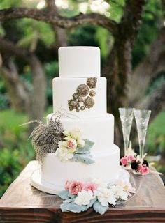 a feathered cake by http://www.vanillabakeshop.com/  Photography by stevesteinhardt.com, Event Design