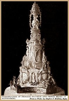 "July 23, 1885 Wedding Cake of Princess Beatrice and Prince Henry of Battenberg.  The artistic cake was surmounted by a replica of Canova's ""Hebe""."