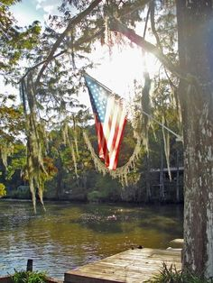 American flag in the sun water outdoors trees usa flag america